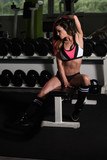 Attractive Young Woman Resting In Gym Afther Exercise - 177075300