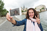 Young woman on holidays in Paris taking selfie in front on Notre Dame - Tourism concept - 177085500