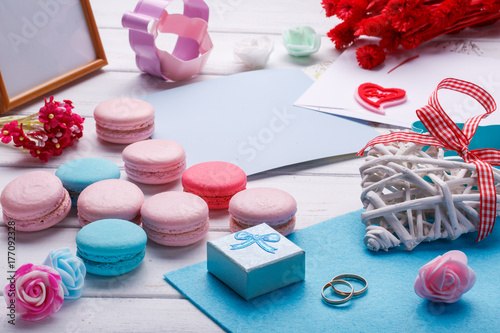 Colorful macaroons. Wedding subject. wedding rings. postcard with envelope