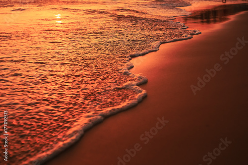 Papiers peints Orange eclat Waves on the beach in the tropics