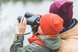 boy looking through binoculars - 177098362