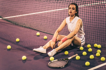 Girl on tennis court