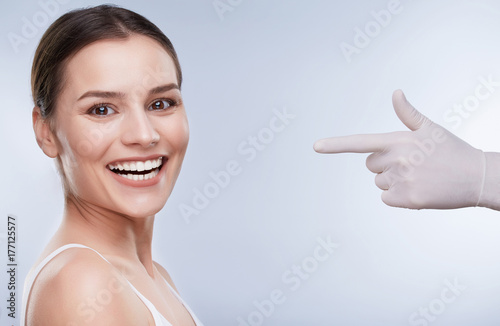 Hand in white glove pointing at patient