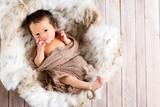 Newborn infant baby boy in a little basket - 177130932