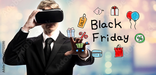 Black Friday text with businessman using a virtual reality headset