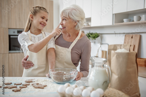 Cheerful family baking pastry together Poster