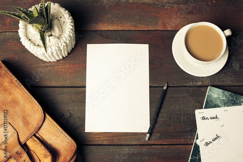 Wall mural Opened craft paper envelope , autumn leaves and coffee on wooden table