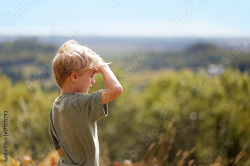 Little Boy Outside on Hike Looking out over Trees on Bluff Poster