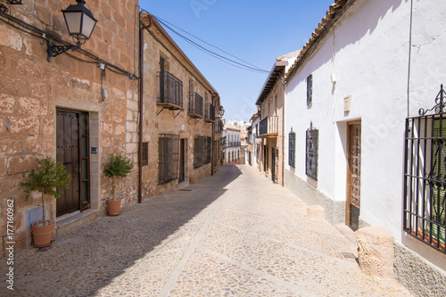 Poster landmark ancient street in old town of Banos de la Encina village, in Jaen, Andalusia, Spain Europe
