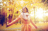 beautiful happy young woman walking in autumn park - 177163173