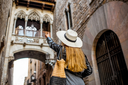 Young woman tourist looking on the famous bridge of Sighs in the old town of Bar Poster