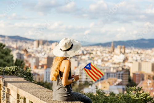 Young woman tourist in hat enjoying great cityscape view on Barcelona Poster