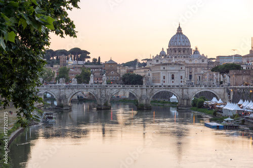 ROME, ITALY - JUNE 22, 2017: Amazing Sunset view of Tiber River, St. Angelo Bridge and St. Peter's Basilica in Rome, Italy