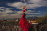 girl in a red dress against a background of florence in italy