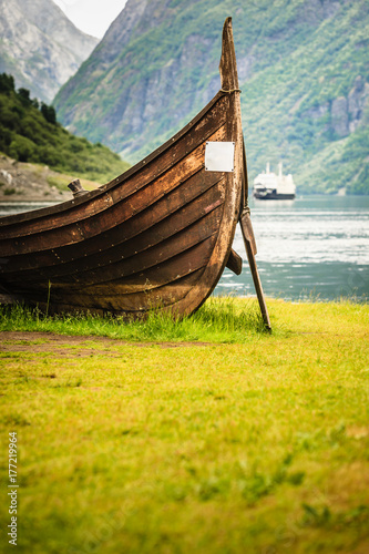 Old viking boat and ferryboat in norwegian fjord Poster