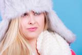 Blonde woman in winter furry hat - 177222194
