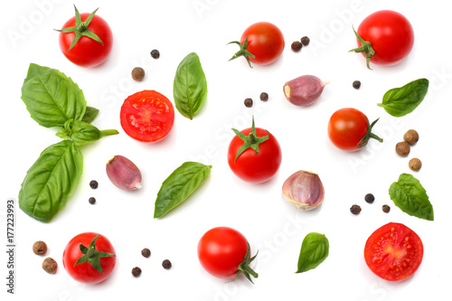 mix of slice of tomato, basil leaf, garlic and spices isolated on white background. top view - 177223993