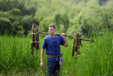 Foreign tourists in Thailand, traditional Thai dress farmer back to nature life concept - 177229913