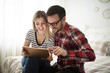 Attractive couple in love using digital tablet