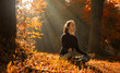 A young woman make yoga position at sunrise. in the autumn forest.