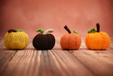 Line of colorful hand knit pumpkins - 177254526