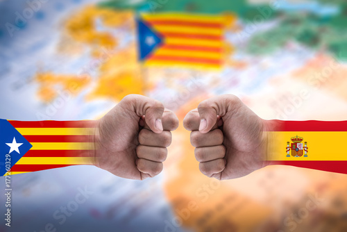 Poster The double exposure image of the isolated arm overlay with Catalonia and Spanish flag and the blurred Catalonia flag image is backdrop