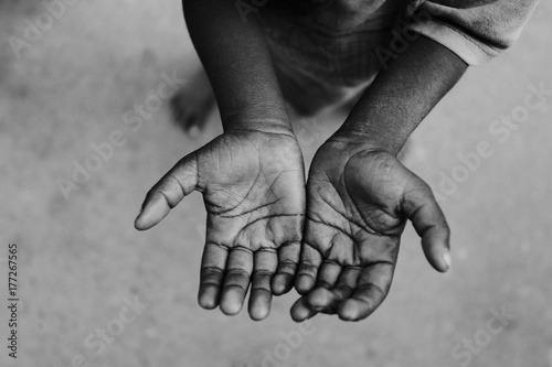 Two beggar hands palms up, India - 177267565