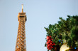 Eiffel tower and Christmas decoration. Selective focus on red balls.