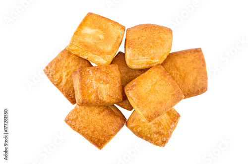Heap of flaky biscuits isolated on white background Poster