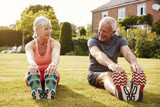 Healthy Senior Couple Exercising In Garden Together - 177290517