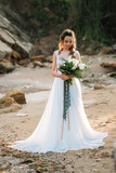 bride with a wedding bouquet on the shore  sea - 177313191