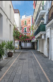 Typical empty street in old town of Ibiza, Balearic Islands, Spain. Morning light. Wide angle