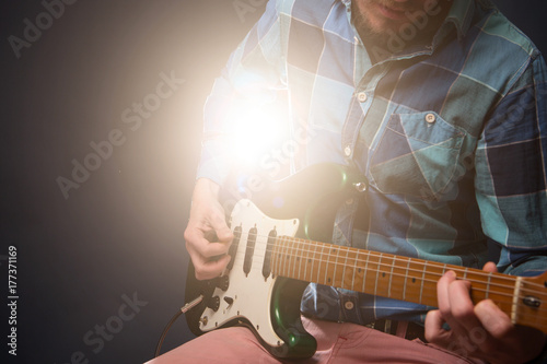 Hands of man playing electric guitar. Poster
