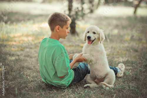 Retriever pup Lovely scene handsom teen boy enjoying summer time vacation with best friend dog ivory white labrador puppy Poster
