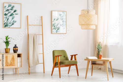 Bright room with green chair