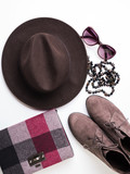 Flat lay with lady's clutch, hat, sun glasses, necklace. Autumn colours accessories and shoes on white background - 177386533