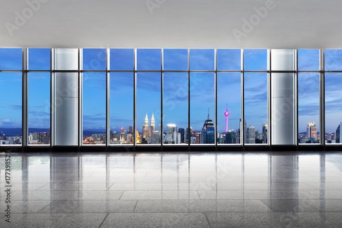 empty office with cityscape of kuala lumpur at twilight Poster