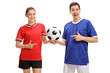 Female footballer and a male footballer pointing