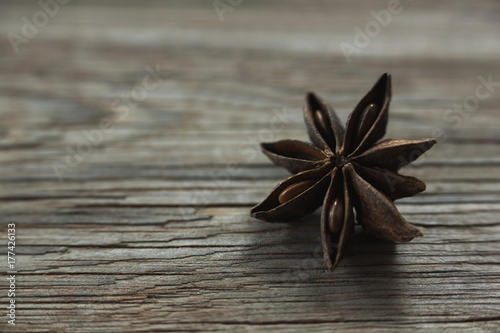 Star anise on wooden table Poster