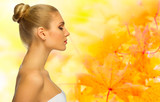 Young woman on autumnal background