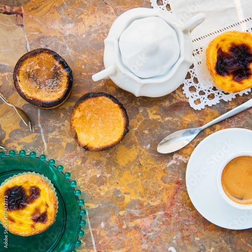 Conceived with the morning coffee and cakes (Pasteis de nata, typical pastry from Portugal) on natural marble surface Poster