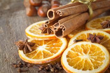 cinnamon sticks, acorn, anise stars, carnation and dried orange slices