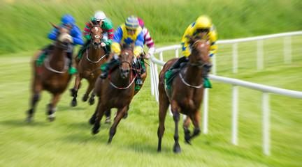 Race horses and jockeys motion blur zoom effect