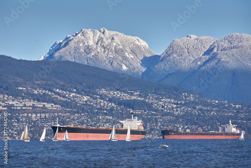 Fridge magnet Freighters and Sailboats, English Bay. The North Vancouver cityscape. Sailboats and freighters in English Bay.