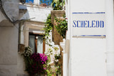 Fototapety Road sign with street dialect name in a Puglia road