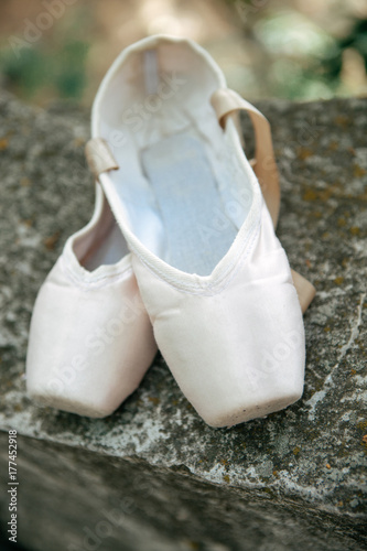 Pointe shoes for a classical ballerina, close-up on concrete Poster