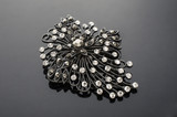 brooch with diamonds isolated on black background - 177461553