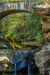 Bridge over Small River with Waterfall in Forest