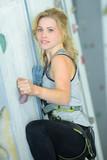 Lady climbing sports wall - 177486121