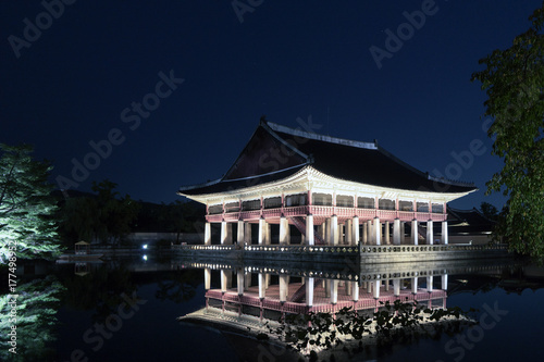 Gyeongbokgung Palace At Night In South Korea, Gyeonghoeru Pavilion is a building Poster